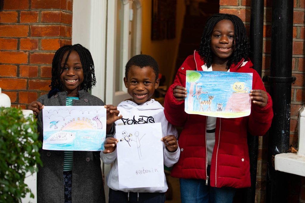 Artwork depicting animals created by left to right Stephanie aged 8 Benjamin aged 6 and Shalomy aged 10 which will be displayed on a row of houses in Acton London. Photo David Parry PA Wire